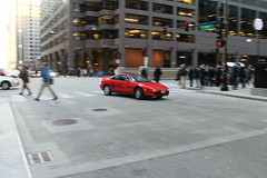 Speeding Toward Spring (Flint Foto Factory) Tags: chicago illinois urban city late winter february 2018 downtown loop 1991 toyota mr2 red midengine sports car coupe moving motion inmotion afternoon rushhour pm traffic retro japanese import boardoftrade mercantile building monroe wacker intersection worldcars