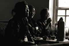 Tea time, Lahsa, Tibet (paola ambrosecchia) Tags: dark portrait asia bnw blackandwhite monochrome light women tibet fineart ritratto luce buoi contrast beautiful travel amazing fujifilm