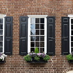 Windows and brickwork arches, lower King Street, Charleston, SC thumbnail