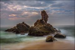 Roca del Paller (jmtostadoc) Tags: girona mar landscape costabrava stones sea catalunya blue amanecer n nubes azul seascape costa greenish a77 sky rocks down verde