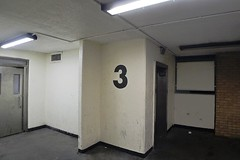 Lifts / stairwell, London estate (alex_hancock) Tags: concrete numbers lift light bold lines wall council towerblock stairwell banal no3 three