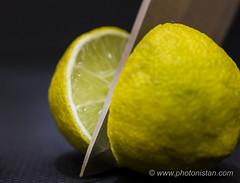 Knife through a Lemon (Photonistan) Tags: macromonday knife macro lemon citrus 40mm28 nikon d7100 photography foodphotography fruit photonistan