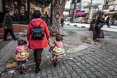Walking home from preschool (Melissa Maples) Tags: istanbul turkey türkiye asia 土耳其 apple iphone iphone6 cameraphone kadıköy rasimpaşa osmanağa moda knitted crochet knitting cosy tree road street girls children twins turks daughters mother