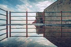 Riflessioni di febbraio (pt.1) (FButzi) Tags: genova genoa liguria italia italy vernazzola riflesso reflection ringhiera railing sky water sea building