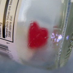My Heart Will Go On / Inside a Bottle (Coyoty) Tags: flickrfriday myheartwillgoon square red heart candy sugar bottle insideabottle photo photography challenge macro bokeh glass gumdrop macromondays clear label food