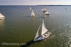Aerial view showing off the mighty sails of a group of traditional Skipjack boats getting ready to compete in the annual Deal Island Skipjack Races, Deal Island, Maryland. (Remsberg Photos) Tags: boat maryland sailing seafood skipjack waterman vessel watervessel fishingboat traditional oysterdredging sailboat easternshore chespeakebay outdoors watermen dealisland coastline leisureactivity bayofwater annualevent competition pursuit sportrace race teamwork adventure activity onthemove motion wind sport sea competitive skipjackraces tradition openwater aerial viewfromabove mast drone sailor summertime summer nauticalvessel usa