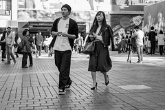 Drifting Apart (burnt dirt) Tags: asian japan tokyo shibuya station streetphotography documentary candid portrait fujifilm xt1 bw blackandwhite laugh smile cute sexy latina young girl woman japanese korean thai dress skirt shorts jeans jacket leather pants boots heels stilettos bra stockings tights yogapants leggings couple lovers friends longhair shorthair ponytail cellphone glasses sunglasses blonde brunette redhead tattoo model train bus busstation metro city town downtown sidewalk pretty beautiful selfie fashion pregnant sweater people person costume cosplay