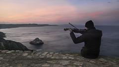 Ogni volta che viene giorno.. (nicolamarongiu) Tags: mare sea sunrise nebida colore violin musica acqua alba sardegna italia assolo