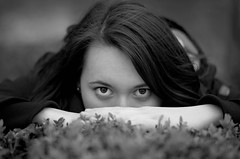 Zsofi (DrQ_Emilian) Tags: face portrait eyes hair girl woman blackwhite bw bokeh details young photoshooting model light nikon photography d5100 hobby monochrome close closeup 50mm thoughts