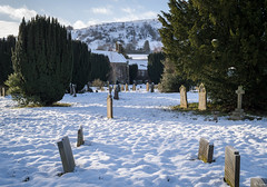 Churchyard Snow (Hector Patrick) Tags: dng flickrelite lightroom614 northyorkmoors northyorkshire pentaxkp rosedaleabbey britnatparks churchyard landscape smcpentaxf28f28 pentax frozen sun outdoors snow
