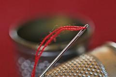 Mother's little helper   HMM (eleni m, longing for spring...) Tags: macromondays lessthananinch macro indoor needle thread thimble hmm red vintage eye dof