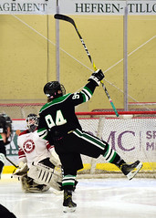 ...the celebration. (R.A. Killmer) Tags: sru skate slippery rock university black green white acha shot goal score net puck slapshot