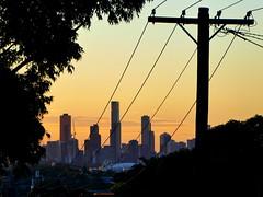 Towards sunset, Melbourne (Diepflingerbahn) Tags: hawthorneast constancestreet 3123 melbourneskyline sunset city powerpole transmissionlines skyscraper dusk polepositions panasoniclumixdmctz80 andersonpark