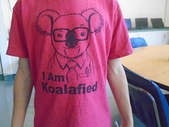 DSC00732 (classroomcamera) Tags: school classroom student kid boy shirt tshirt portrait koala koalafied joke fun funny saying quote glasses office tie nerd job interview arms stand standing