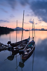 long tail boats (Traveloscopy) Tags: tourism boat phuket sunset water sea thailand andaman island landscape asia travel nature destination sky summer lagoon scenery vacation ocean tropical recreation tranquil journey longtail sunrise transport local traditional fishing