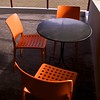 Silent Conversation (Padmacara) Tags: australia fremantle chairs table square orange g11 shadowlight