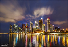 Colourful Singapore (AdelheidS Photography) Tags: adelheidsphotography adelheidsmitt adelheidspictures skyline cityscape city canoneos6d cityview citylights singapore asia colour colourful bluehour blauwuurtje waterfront water clouds irix 15mm skyscraper sky building buildings