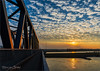 Railway Bridge in Sunset (Hans van Bockel) Tags: hdr ijssel ijsselkade rivier spoorbrug sunset water zon zonsondergang deventer overijssel nederland nl nikon 1680mm d7200 brug bridge railwaybridge river wolken clouds sky oranje orange luminar2018