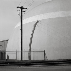 Portland (austin granger) Tags: portland telephonepole tank shadow wires fence bent sphere geometry industry industrial sidewalk tracks traintracks square film gf670
