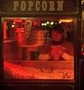 Pop that corn (PeterThoeny) Tags: disneyland anaheim california popcorn popcornstand popcornmachine stand food woman person red night hdr 1xp raw nex6 sel50f18 photomatix qualityhdr qualityhdrphotography fav100