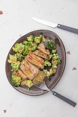 Served grilled pork with marinated broccoli. (annick vanderschelden) Tags: pork meat grilled sliced broccoli chops oliveoil warm readytoeat served plate pottery marinade honey ginger redwinevinegar mustard