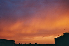 A storm of sunset 1.1 (CristinaDiaconu23) Tags: analog analogue analogphotography film 35mm filmclub filmisalive filmphotography filmcamera dusk sunset sunsetcolours orange rainbow twilight home summer color shadow burn sky landscape city