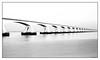Endless. (moniquevantorenburg) Tags: bridge zeelandbrug thenetherlands water oosterschelde longexposure le monochrome zwartwit blackandwhite endless longbridge m43 microfourthirds olympusomdem5markii olympus124028pro perspective