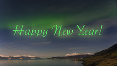 Happy New Year's Eve and a Happy 2018 (lunaryuna) Tags: iceland akureyri fjord northiceland landscape seascape sky nightsky nocturnalsky nocturnalphotography nightphotography starrynight northernlights auroraborealis nordlichter mountainrange snowcappedmountains beauty clouds stars celestialfireworks happynewyear lunaryuna