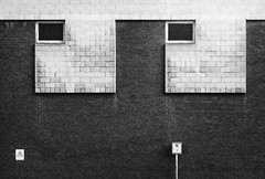 Silver Street Head (Delay Tactics) Tags: sheffield wall windows building architecture parking sign squares film black white bw eyes