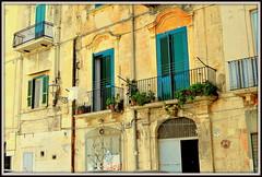 Facades usees par le temps de maisons a Bari en Italie. (scoubidou13) Tags: italie bari facade jaune rue street ville city