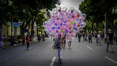 The Balloon Seller (voxpepoli) Tags: hanoi hànội vietnam vn balloons balloon balloonseller streetvendor street streets colours heart hearts people crowd