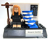 The completed built of Margaret Hamilton's build features a stack of book elements, representing the books of listings of Apollo Guidance Computer (AGC) (WhiteFang (Eurobricks)) Tags: lego ideas space designer scientist astronaut rocket science females ladies licensed satellite spaceship printed nasa