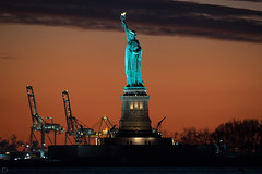 Sunset behind The Statue of Liberty (dansshots) Tags: sky orange statue statueofliberty ladyliberty sunset sunsetcolors endoftheday nikon nikond750 dansshots sigma300800mm iloveny nyc newyorkcity