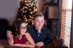 Christams Eve (Rebecca812) Tags: brother sister twins happiness excitement dressedup laughter family love enjoyment home livingroom christmastree eyeglasses ten boy girl portrait togetherness red green sweet beautiful twinklelights rebeccanelson rebecca812 canon