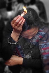 Smoke purification (posterboy2007) Tags: hindu kathmandu nepal ritual smoke purification woman nepali red sony