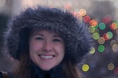 Winter Warmth (christopherdeacon) Tags: people winter bokeh woman girl fur fujifilmxt1 meyeroptik meyeroptiktrioplan meyeroptiktrioplan100mm cold face twinkle lights soft dof depthoffield dusk outdoors