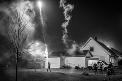 20180102_F0001: Ready, aim, fire fireworks (wfxue) Tags: fireworks smoke houses road suburb car family light explosions newyearseve celebration people candid street blackandwhite bw bnw monochrome