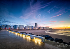 Ostend Sunset (Alec Lux) Tags: hdr hdrphotography ostend beach belgium bench bluehour city cityscape coast coastline goldenhour landscape landscapephotography lights nature naturephotography ocean pier pontoon scenic sea seascape seascapephotography seat sky skyline smooth sunlight sunset water waves oostende be