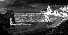 Sun, sea and shadows (Peter Leigh50) Tags: dorset landscape seascape blackandwhite black white bw shore sea water mono monochrome cliff beach people shadows shade fuji fujifilm xt10