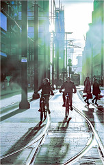 Into The Light (Fermat 48) Tags: manchester mosleystreet cyclists cycles tram tramlines flair shadows silhouette reflections canon eos 7dmarkii ef24105mmf4lisusm cold warmth temprature