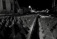 Distant Platform. Dec 2017 (SimonHX100v) Tags: lincoln lincolnshire blackandwhiteblackandwhite blackwhite monochrome monotone greyscale grayscale bw bnw sepia coloursplash lincolncentralstation lincolnrailwaystation perspective pointofview lowpov pov depthoffield dof reflection reflections mirror mirrorimage december december2017 winter winter2017 simonhx100v sonydschx100v sonyhx100v hx100v sonycybershotdschx100v