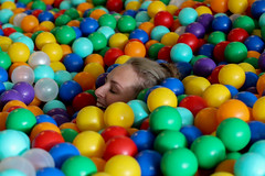 Where's your head at? (Josiedurney) Tags: summer eastlondon summerinthecity londonlife fun hipster cool birthday towerhamlets university colour ballpit balls child children play boxpark shippingcontainer shoreditch girl cute smile camera action