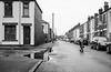 blackpool streets (streetstory) Tags: blackpool england bw streetphotography terracedhouses kidonascooter 2017