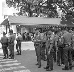 Police Mill About (Dennis M Chua) Tags: blackandwhitephotography streetphotography police parade antipolo rizalprovince philippines 120film filmphotography believeinfilm istillshootfilm kodak tmy400 zeiss superikontabx 53316 8028zeisstessar vintagecamera foldercamera mediumformat