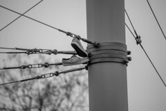 Hanging around (Aroundniceplaces) Tags: shoes black white hanging zurich city urban switzerland pole metal