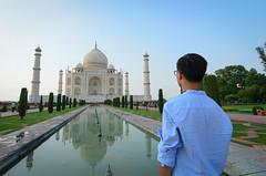 A young tourist looking at Taj Mahal (phuong.sg@gmail.com) Tags: adventure agra ancient architecture asia asian back backpack backpacker building camera culture destination heritage holiday india journey landmark landscape lifestyle looking male man monument outdoor palace people rear religion summer sun tajmahal temple tomb tourism tourist tower travel traveler traveller vacation view watching world young