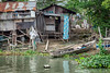 Taguig home (damonlynch) Tags: asia filipino nationalcapitalregion pasigriver people philippines taguig boats ecology ecosystem environment environmentalism female feminine girl humanbeings humans nature outdoor outdoors outside paddleboats person pollute polluted pollution poor poverty river scenery socialissue socialissues tributary water waterpollution