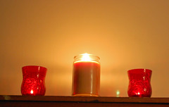 Three Candles. (dccradio) Tags: lumberton nc northcarolina robesoncounty indoors inside candle candles burning illuminated flame redcandleholder candleholder tealightcandle jarcandle wall fire nikon d40 dslr tealight red light candlelight