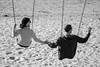 Love in the Age of Selfies (lorinleecary) Tags: avilabeach californiacentralcoast sanluisobispo beach blackandwhite cellphone man romance selfie swings woman