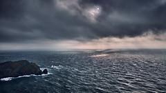 Nez de Jobourg (PascallacsaP) Tags: sea cape waves roughweather wind share coast rocks cliffs manche normandie france bassenormandie sun filtered sunlight heavy clouds reflections dark normandy jobourg cotentin stormyweather stormy windy